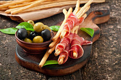 Grissini bread sticks with ham Royalty Free Stock Photo
