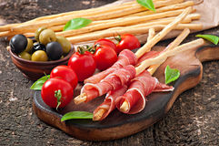 Grissini bread sticks with ham Royalty Free Stock Images