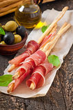 Grissini bread sticks with ham Royalty Free Stock Photography