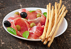 Grissini bread sticks with ham Stock Images