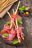 Grissini bread sticks with ham Royalty Free Stock Photos