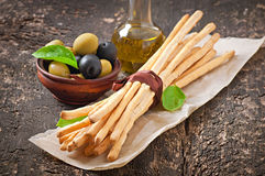 Grissini bread sticks. On old wooden background stock photography