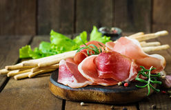 Grissini bread sticks with prosciutto Royalty Free Stock Image