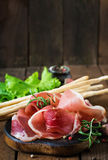 Grissini bread sticks with prosciutto Stock Photos