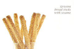 Grissini bread sticks with sesame. Isolated on white Royalty Free Stock Images