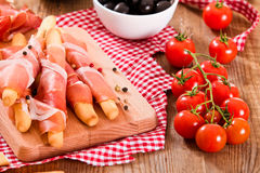 Grissini breadsticks with ham. Stock Photo