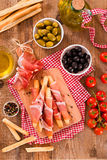 Grissini breadsticks with ham. Stock Images