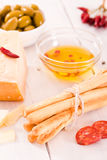 Grissini breadsticks with salami. Royalty Free Stock Images