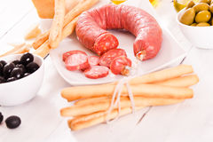 Grissini breadsticks with salami. Stock Photo