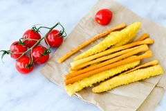 Grissini. Different types of grissini - tradition Italian breadsticks and mini san Marzano italian cherry tomatoes. Mediterranian lunch royalty free stock photography