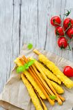 Grissini. Different types of grissini - tradition Italian breadsticks and mini san Marzano italian cherry tomatoes. Mediterranian lunch royalty free stock images
