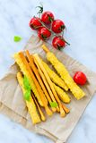 Grissini. Different types of grissini - tradition Italian breadsticks and mini san Marzano italian cherry tomatoes. Mediterranian lunch royalty free stock photo