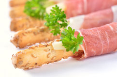 Grissini with ham Stock Photography