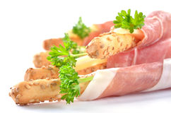 Grissini with ham. Grissini with cheese sticks wrapped with Italian Parma ham stock image