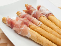 Grissini and ham Royalty Free Stock Image
