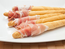 Grissini and ham Stock Images