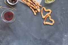 Grissini hearts and sticks traditional italian snack, food composition on black chalkboard background stock photography