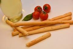 Grissini italians snack tomato oil. Food italian snack Royalty Free Stock Photos