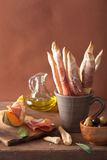 Grissini with prosciutto cantaloupe melon olives. italian appeti Royalty Free Stock Photography