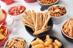 Grissini salty sticks with sesame and other savory snack Royalty Free Stock Photos