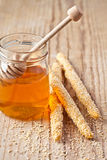 Grissini with sesame seeds and honey Royalty Free Stock Photography