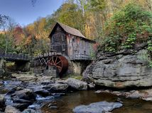 Grist mill on Glade Creek, Babcock State Park, WV. Old wooden grist mill on waterfront of Glade Creek in Babcock State Park, West Virginia Stock Images