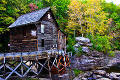 Grist Mill. Picture of old grist mill during the early fall, from the side Stock Photography