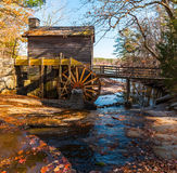 Grist Mill in Stone Mountain Park, USA. Grist Mill and creek flowing into the lake in the Stone Mountain Park in sunny autumn day, Georgia, USA Royalty Free Stock Photos