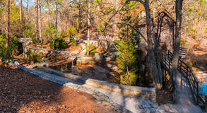 Grist Mill in Stone Mountain Park, USA. Panoramic view of the Grist Mill and creek flowing into the lake in the Stone Mountain Park in sunny autumn day, Georgia Royalty Free Stock Images