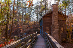 Grist Mill in Stone Mountain Park, USA. View of the Grist Mill and thicket from the bridge in the Stone Mountain Park in sunny autumn day, Georgia, USA Royalty Free Stock Photos