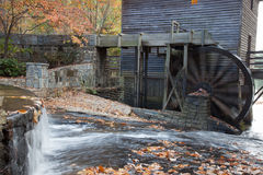 Grist mill with water wheel Stock Image