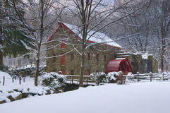 Grist mill in winter. Grist Mill at The Wayside, Sudbury, Massachusetts, shot on a snowy day at dawn Royalty Free Stock Images