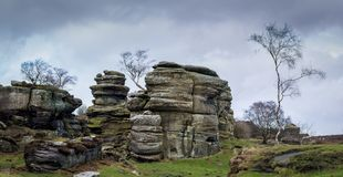 Grit rock outcrop at historical Brimham rocks in Yorkshire. Grit rock outcrop at historical Brimham Rocks on Brimham moor near Pateley Bridge in Yorkshire Stock Photography
