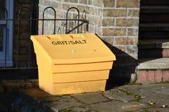 Grit and salt bin. Yellow plastic grit and salt bin Royalty Free Stock Photo