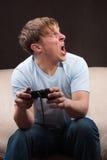Gritando o gamer Imagem de Stock