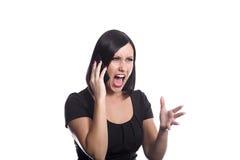 Gritar no telefone Fotografia de Stock
