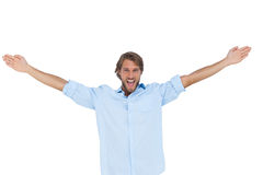 Gritaria considerável do homem com suas mãos levantadas Imagem de Stock Royalty Free