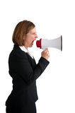 Gritaria da mulher de negócios em um megafone Fotografia de Stock Royalty Free