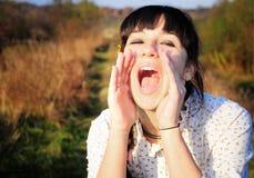 Griterío de la mujer joven de la alegría Fotografía de archivo libre de regalías