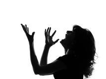 Griterío enojado de la mujer de la silueta Foto de archivo libre de regalías