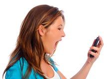 Grito adolescente con el teléfono celular Fotos de archivo