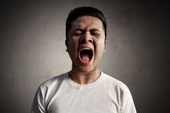 Grito asiático del hombre muy ruidosamente Fotografía de archivo