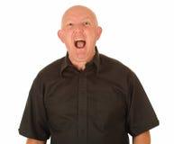 Grito calvo enojado del hombre Fotografía de archivo libre de regalías