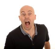 Grito calvo enojado del hombre Imagen de archivo libre de regalías