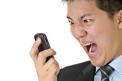 Grito del hombre de negocios al teléfono Fotografía de archivo