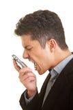 Grito en teléfono celular Imagenes de archivo