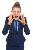Grito enojado de la mujer de negocios Foto de archivo libre de regalías