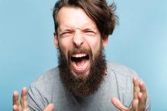 Grito irritado do homem da divisão emocional da fúria da raiva imagens de stock royalty free