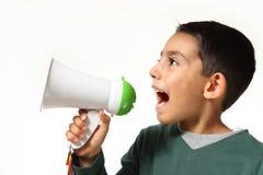 Grito joven del muchacho en megáfono Imagenes de archivo