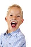 Gritos consideráveis do menino ruidosamente fotografia de stock